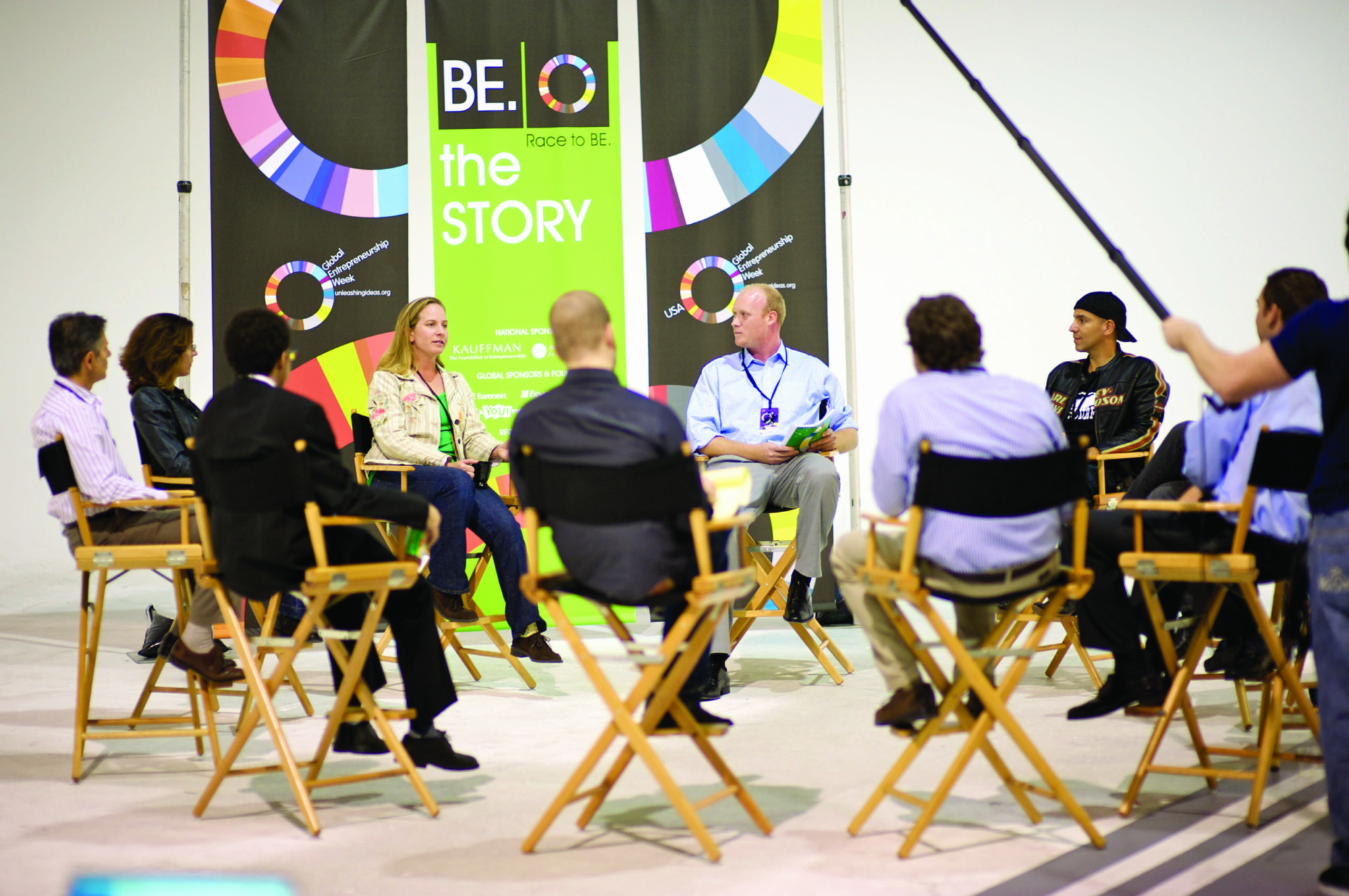People sitting in a circle at a corporate event